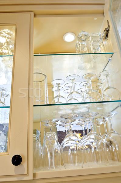 Konyhaszekrény közelkép üveg polcok szemüveg fa Stock fotó © elenaphoto