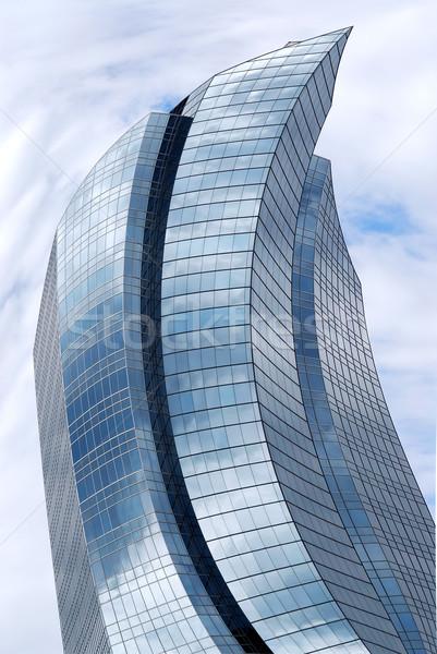 Vervormd wolkenkrabber futuristische corporate gebouw glas Stockfoto © elenaphoto