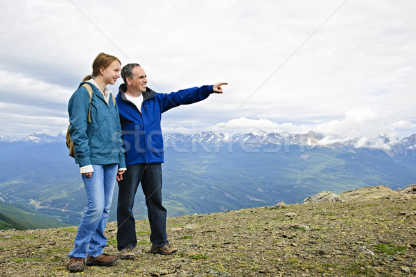 Father and daughter in mountains Stock photo © elenaphoto