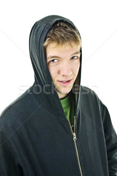 Young man in hoodie smiling Stock photo © elenaphoto