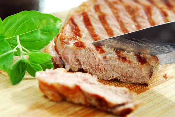 Grillezett steak vág vágódeszka közelkép vacsora Stock fotó © elenaphoto