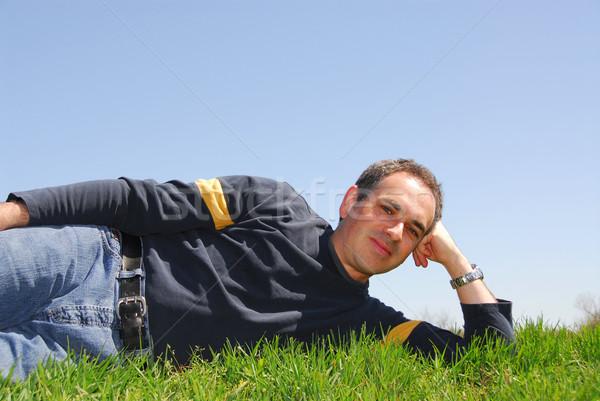 Hombre hierba cielo fuera sin nubes cielo azul Foto stock © elenaphoto