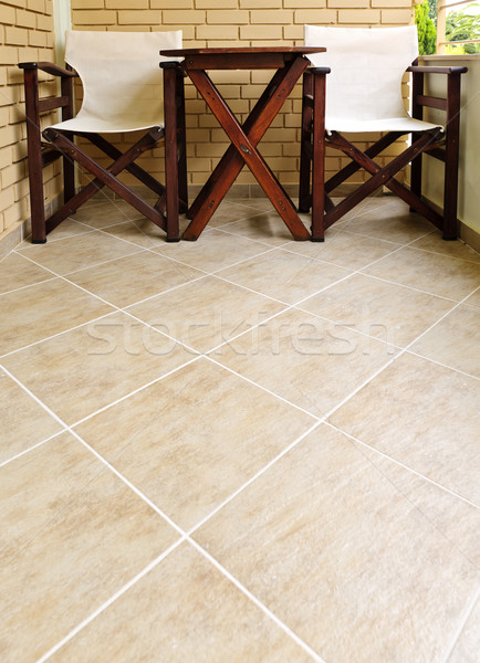 Chairs and table on tiled floor Stock photo © elenaphoto