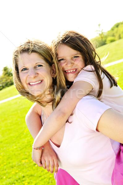 Mãe filha piggyback retrato feliz família Foto stock © elenaphoto