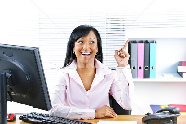 Businesswoman having idea at desk Stock photo © elenaphoto