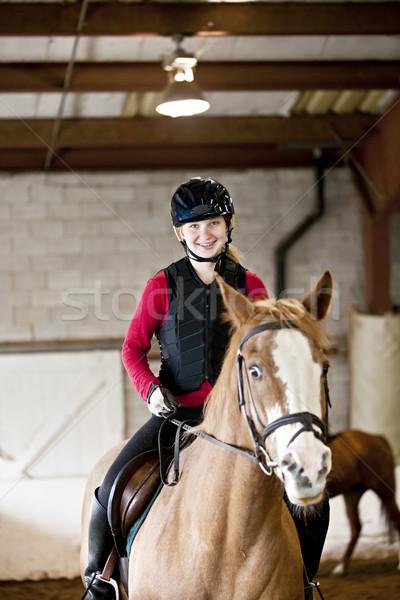 Teen girl riding horse Stock photo © elenaphoto
