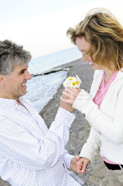 Mature romantic couple with flowers Stock photo © elenaphoto