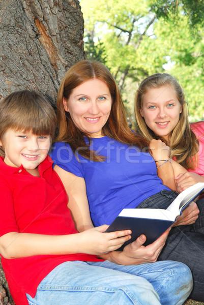 Family reading a book Stock photo © elenaphoto