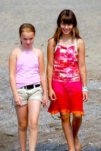 Two girls walking Stock photo © elenaphoto