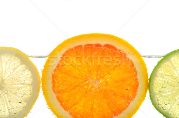 Orange citron chaux tranches eau air Photo stock © elenaphoto