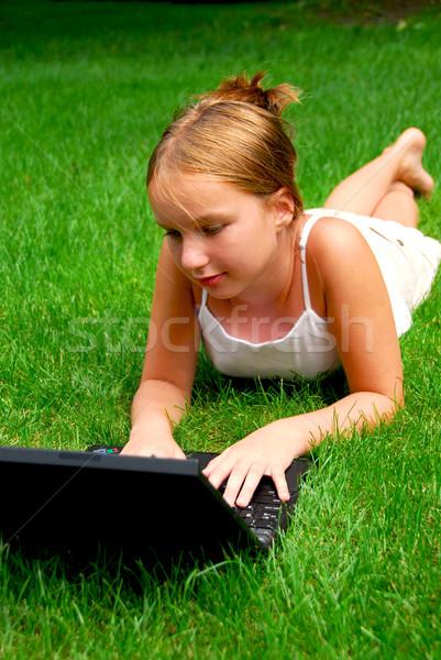 Girl computer grass Stock photo © elenaphoto
