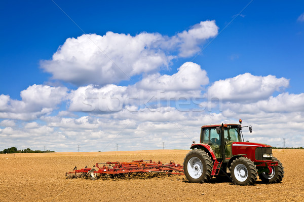 Tractor in plowed field Stock photo © elenaphoto