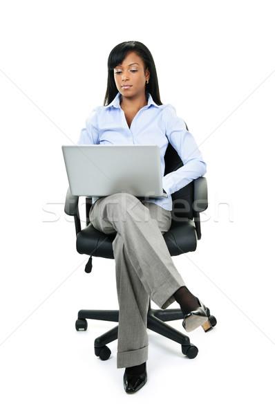 Kadın oturma ofis koltuğu bilgisayar genç ciddi Stok fotoğraf © elenaphoto