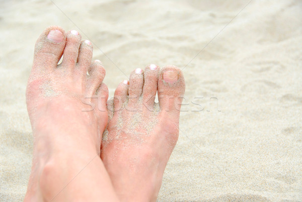 Homokos láb tengerpart test kereszt festék Stock fotó © elenaphoto