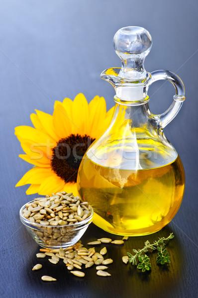 Napraforgóolaj üveg nyers magok virág fény Stock fotó © elenaphoto