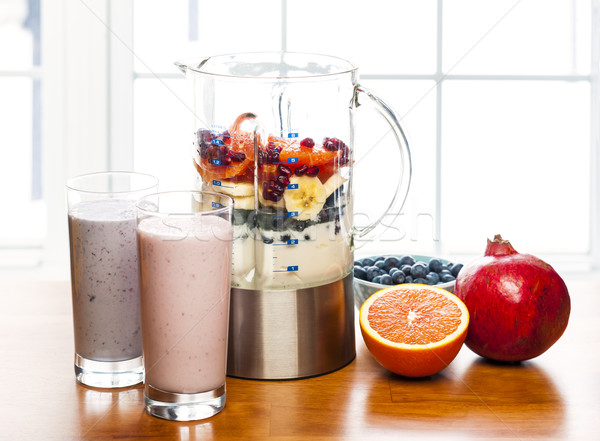 Making smoothies in blender with fruit and yogurt Stock photo © elenaphoto