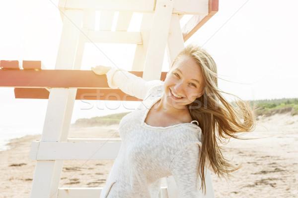 Carefree young woman on beach Stock photo © elenaphoto