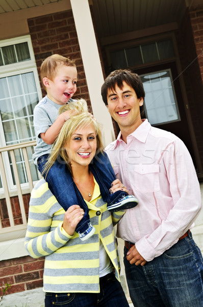 Stock photo: Happy family in front of home