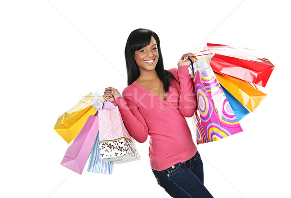 Happy young black woman with shopping bags Stock photo © elenaphoto