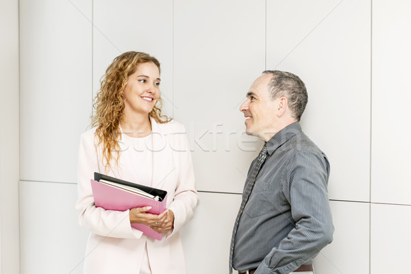 Business coworkers talking in hallway Stock photo © elenaphoto