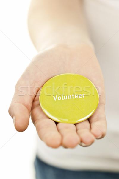 Volunteer button on hand Stock photo © elenaphoto