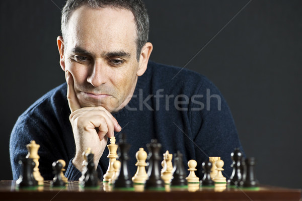 Man at chess board Stock photo © elenaphoto