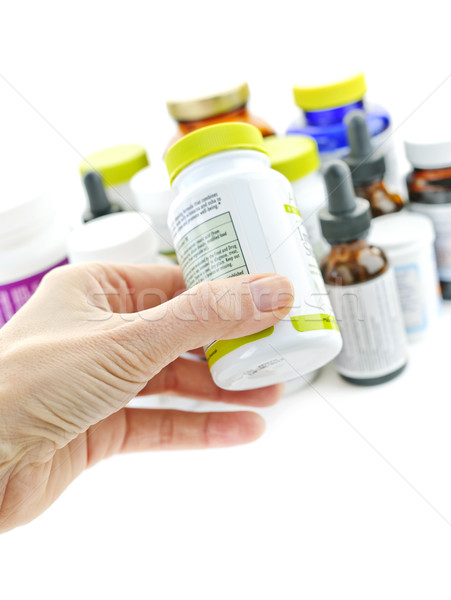 Hand holding medicine bottle Stock photo © elenaphoto