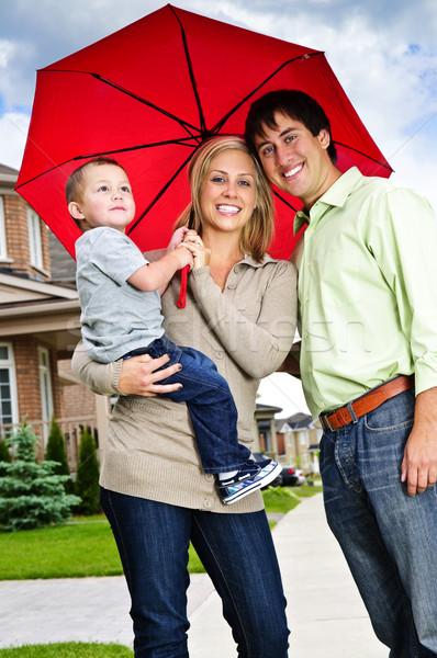 Happy family with umbrella Stock photo © elenaphoto