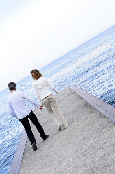 Mature romantic couple on a pier Stock photo © elenaphoto