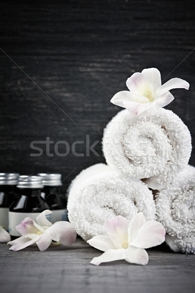 Rolled up towels and products at spa Stock photo © elenaphoto