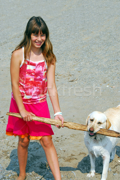 Girl play dog Stock photo © elenaphoto
