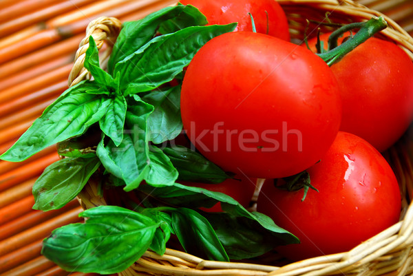 Tomatoes and basil Stock photo © elenaphoto