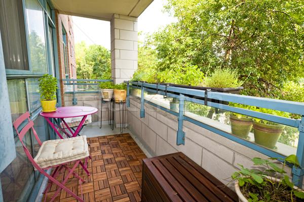 Lakás erkély kerti bútor növények épület fák Stock fotó © elenaphoto