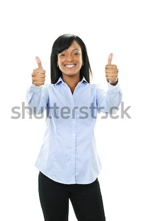Smiling young woman giving thumbs up Stock photo © elenaphoto