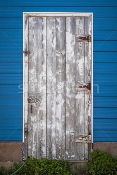 Edad puerta capeado lado azul Foto stock © elenaphoto