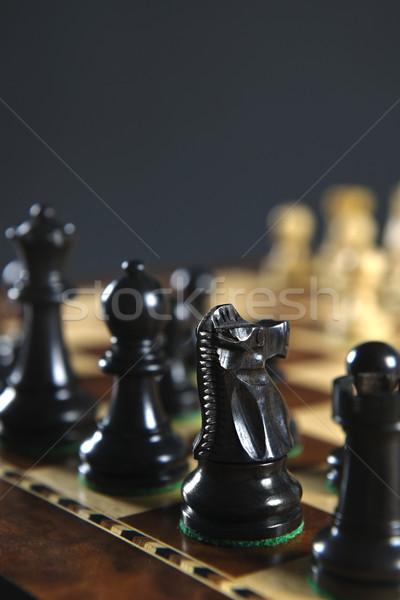 Foto stock: Negro · piezas · de · ajedrez · bordo · tablero · de · ajedrez