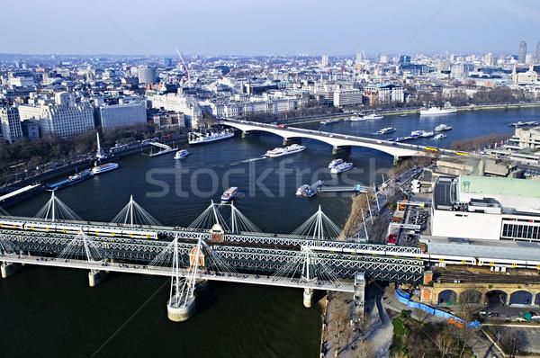 Híd London szem Anglia épület kereszt Stock fotó © elenaphoto