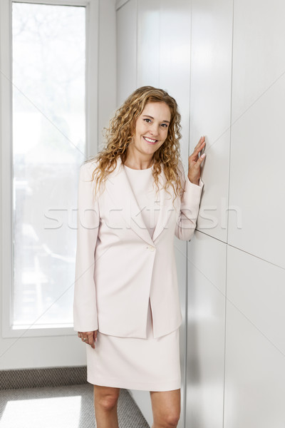Businesswoman standing in hallway Stock photo © elenaphoto