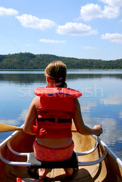 Child in canoe Stock photo © elenaphoto