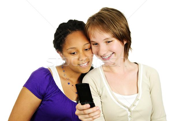 Teen girls with mobile phone Stock photo © elenaphoto