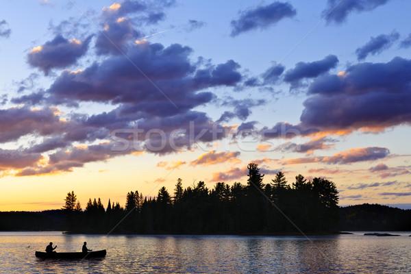 Canoe on lake at sunset Stock photo © elenaphoto