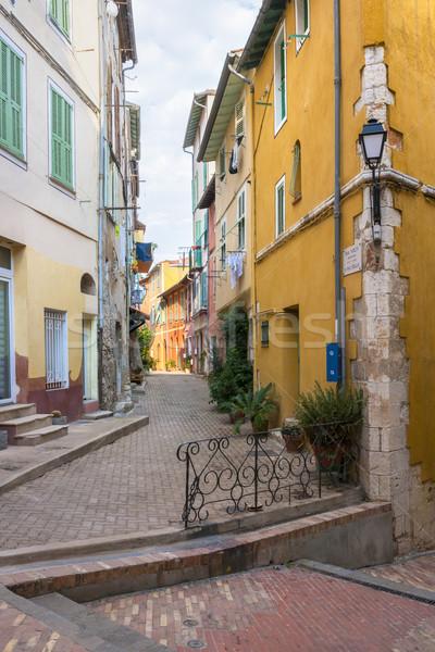 Straße Kreuzung schmal farbenreich alten Gebäude Stock foto © elenaphoto