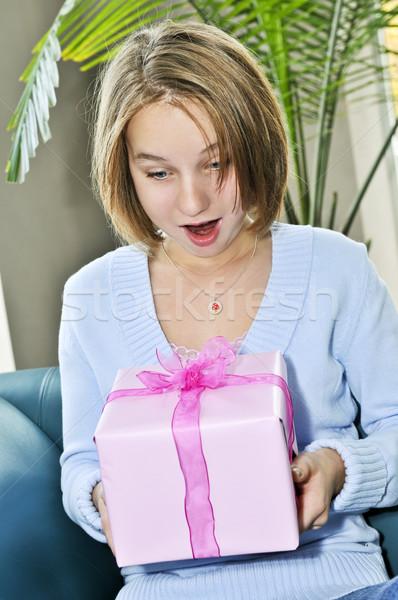 Stock photo: Teenage girl with present