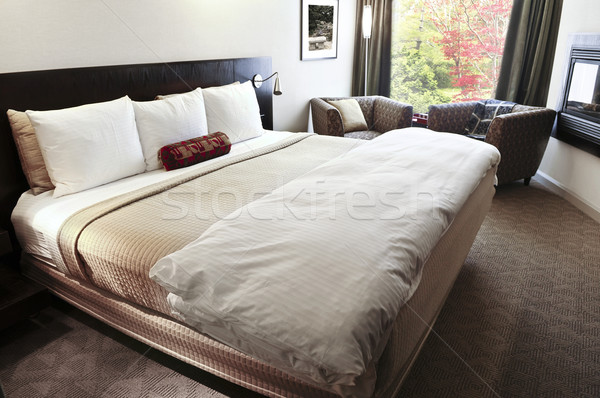 Bedroom with comfortable bed Stock photo © elenaphoto