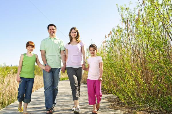 Mutlu aile portre dört yürüyüş aile kız Stok fotoğraf © elenaphoto