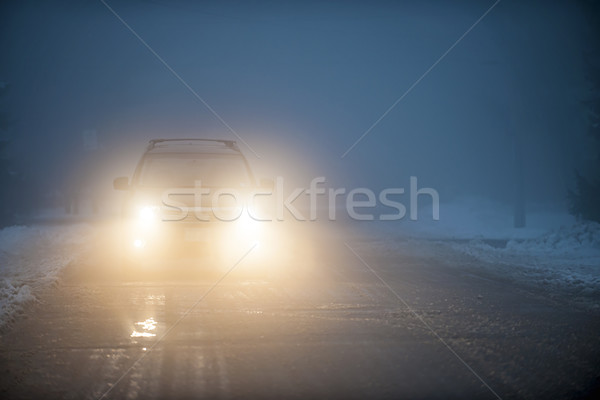 Headlights of car driving in fog Stock photo © elenaphoto