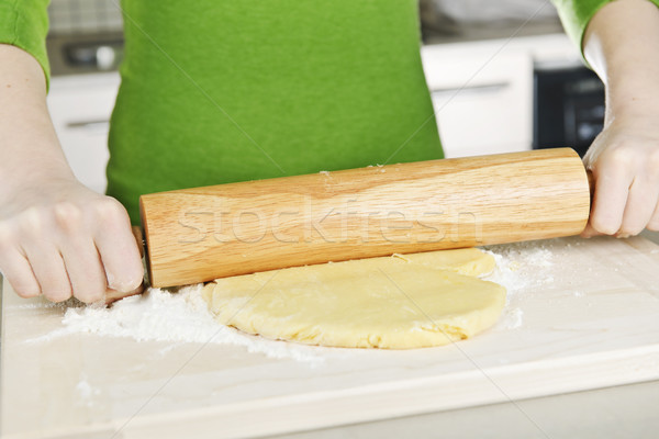 Hands with rolling pin and cookie dough Stock photo © elenaphoto