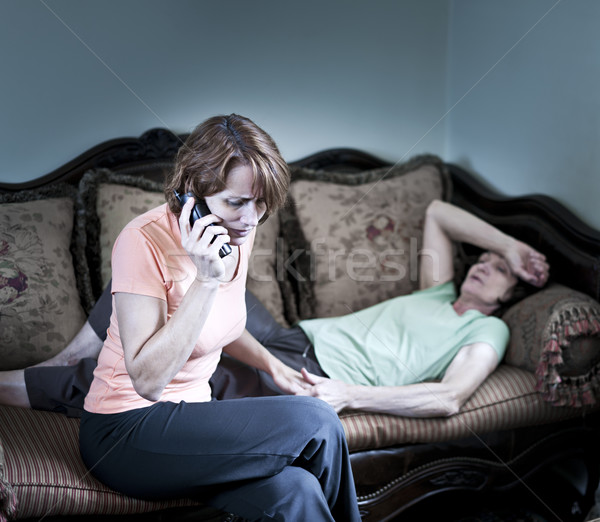 Concerned woman with sick mother Stock photo © elenaphoto