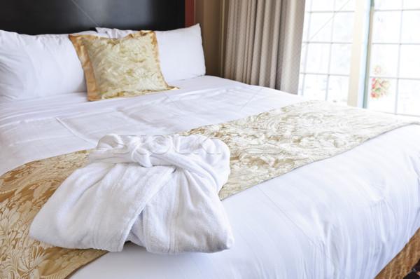 Hotel ágy fürdőköpeny kényelmes tiszta előkelő Stock fotó © elenaphoto