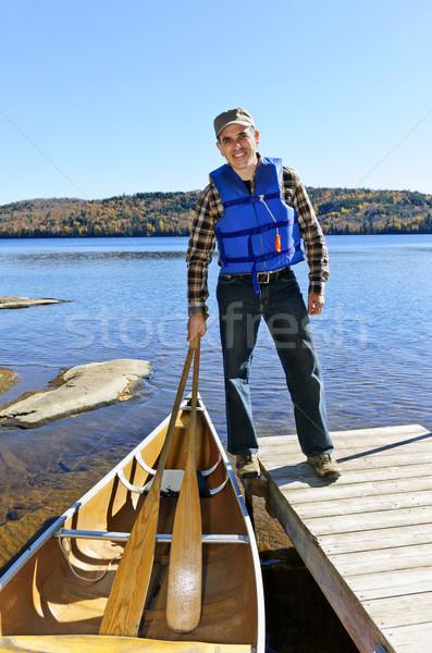 Man with canoe Stock photo © elenaphoto